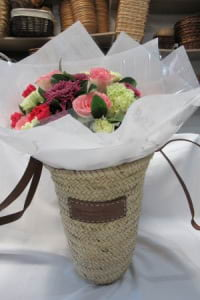 Woven French Market Basket with bouquet of flowers