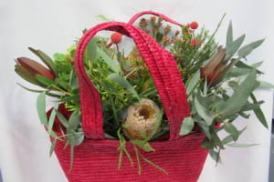 Bouquet of native flowers in a beach bag