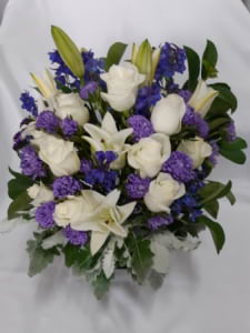 White and Blue Arrangement in a Glass Vase